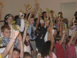 lesson students showing off their trophies