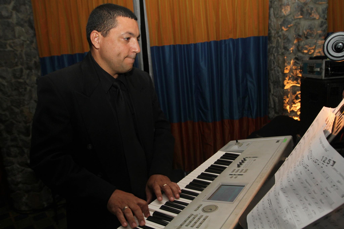 Piano teacher Juan performing the keyboard