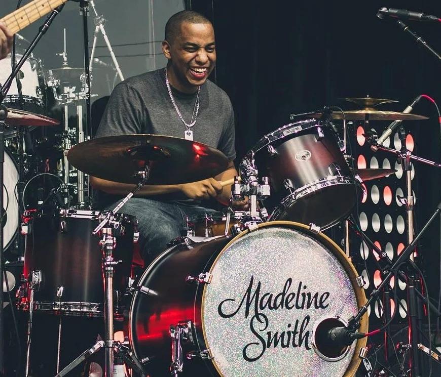 drum teacher performing on stage